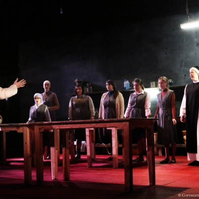 Rebecca Rodgers (Suor Angelica) and Ensemble in Suor Angelica. Photo by Frances Marshall.