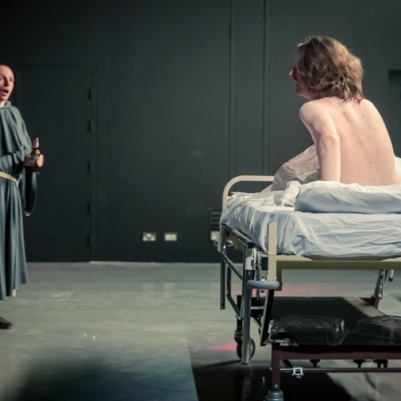 Fionntán Larney (Jussup) and ensemble in The Caucasian Chalk Circle. Photo by Keith Dixon.