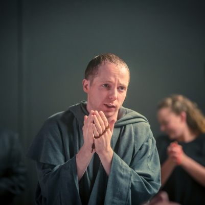 Kyle Hixon (Monk) and ensemble in The Caucasian Chalk Circle. Photo by Keith Dixon.